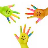 Three colorful hands with smile painted on palm — Stock Photo