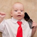 Newborn baby talking on mobile phone — Stock Photo