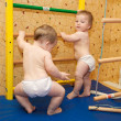 Two baby twins playing sports and climbing the stairs — Stock Photo