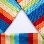 Triangular frame of multicolored knitted fabric. — Stock Photo
