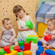 Three sisters - a preschooler girl and two twins baby — Stock Photo