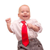 Newborn baby in a business suit and red tie. — Stock Photo