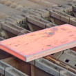 Hot steel on conveyor — 图库照片