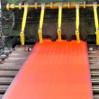 Hot steel on conveyor — Stock Photo #11146056