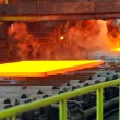 Hot steel on conveyor — Stock Photo #11346012