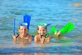Children on beach with snorkles — Stock Photo