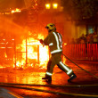 Стоковое фото: Firefighter putting out fire