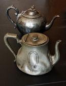 Antique pewter teapots — Stock Photo