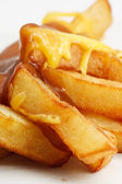 Chips, cheese and gravy — Stock Photo