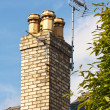 Stock Photo: Television aerials on chimney