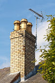 Television aerials on chimney — Stock Photo