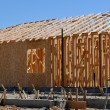 Stock Photo: New Home Under Construction with Foundation