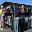 Clothes for Sale at Flea Market - Stock Photo