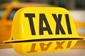 Yellow and Black Taxi Cab Car Sign — Stock Photo