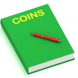 Stock Photo: COINS inscription on cover book