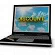 DISCOUNT sign on laptop screen - Stock Photo