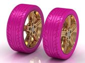 2 pink wheels with a gold disc — Stock Photo