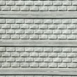 Gray modern stone wall — Stockfoto #11376363