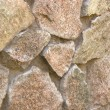 Fieldstone wall under the sun - Stock Photo