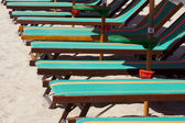 Sunbeds and parasols — Stock Photo
