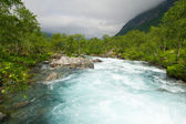 Milky blue glacial water of Briksdal River in Norway — Stock Photo