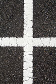 Asphalt with cross white line — Stock Photo