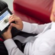 Young businessman holding and touching a digital tablet — Stock Photo
