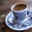 Traditional Turkish coffee served in cup on wooden table — Stockfoto