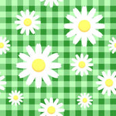Chamomiles on green checkered background — Wektor stockowy