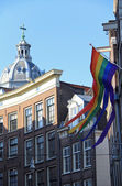 Gay flag waving , Amsterdam , Netherlands ( Holland ) — Stock Photo
