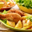 Fried drumsticks with french fries — Stok fotoğraf