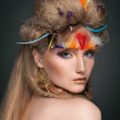 Beauty portrait in feathers — Stock Photo