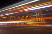 Night traffic at Colosseum — Stock Photo