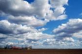 Farm with cloudy sky — Stock Photo