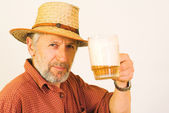 Elderly guy with a mug of beer — Stock Photo