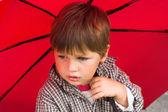 Boy with the umbrella — Stock Photo