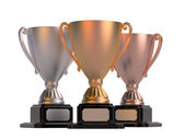 Gold, silver and bronze cups — Stock Photo