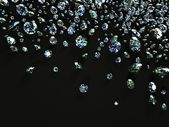 Diamonds scattered on black surface — Stock Photo