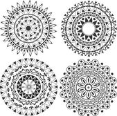 Lacy decoration in the form of mandalas — Stock Vector