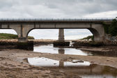 Concrete bridge over the water — Stock Photo