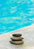 Stones on pool edge — Stock Photo