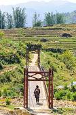 Woman across a bridge — Stock Photo