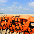 Stock Photo: Life jackets at beach