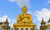 Smiling Buddha statue — Stock Photo