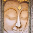 Buddha face carved stone in Thai style — Stock Photo