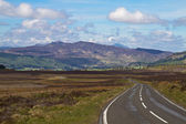 Road through the scottish highlands — Stock Photo