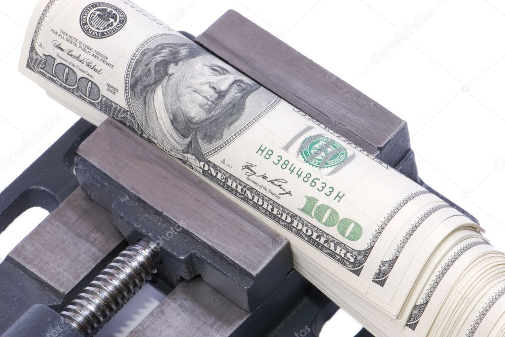 American dollars being crunched in a press, insulated  Stock Photo #11015796