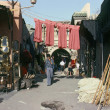 MARRAKECH, MOROCCO – AUGUST, 1979: walking down a shopp — Stock Photo