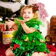 A girl under the Christmas tree with gifts — Stock Photo #10799092