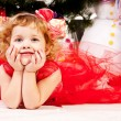 Stock Photo: A girl under the Christmas tree with gifts